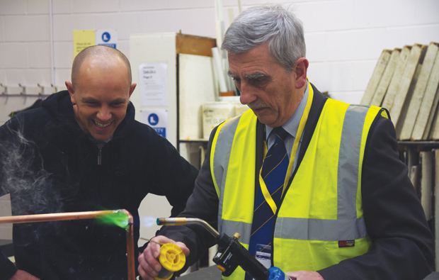 Leader of local council gets a masterclass in plumbing at Warrington Collegiate