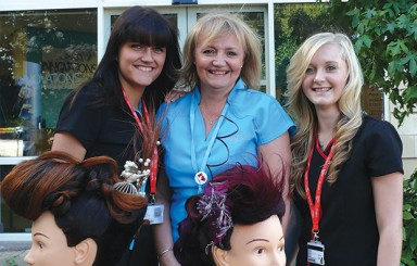 From left: hairdressing student Luize Rotberga, 20, lecturer Debbie Williams. and student Harriet Bowring, 17, show off their skills outside Burton and South Derbyshire College?s Innovations hair and beauty salon