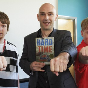 Ex-con and author Shaun Attwood demonstrates a prison greeting to Macclesfield College students Michael Chisholm (left) and Phillip Morrall