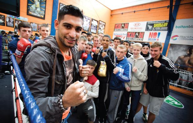 Gloves come off for Amir Khan visit