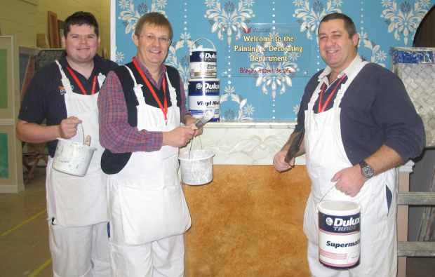 Dulux reps get their hands dirty