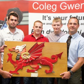 The artwork presented to the Gwent Dragons, Dragons education officer Phil James, students Danny Vincent, aged 19, Thomas Holloway, 20, and Daniel Kerslake, 18, Dragons community manager Mike Sage and Coleg Gwent head of school for engineering Mark Southcott