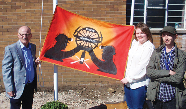 Flag honours 89 miners who perished