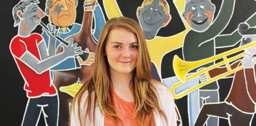 Sarah Blackwell and the mural she brought back to life