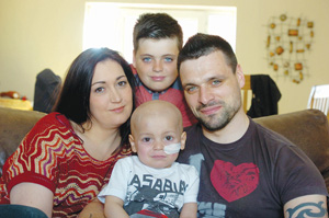 Inset: Bradley Lowery with mum Gemma, dad Carl and brother Kieran, aged 11
