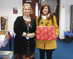Lauren Clark, aged 17, receiving a hamper last year from College director of work-based learning and school partnerships Julie McLean