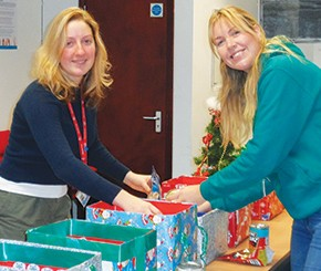 Lecturers Danielle Welton and April Howell packing hampers
