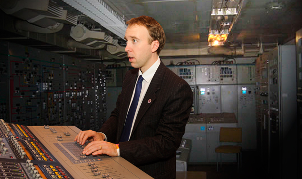 Skills minister, Matthew Hancock testing out the new control panel facilities at Prafilloso Ltd in Derby.