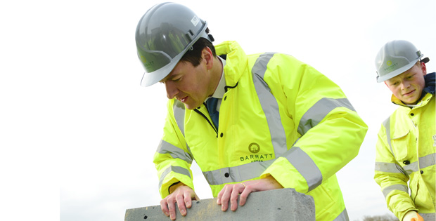 Apprentice gives Osborne tips on bricklaying