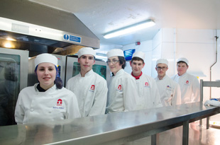From left: Students Bethany Redhead, aged 19, Jack Allen and Cameron Goldie, both 18, William Kerry, 19, Tom Stevenson, 19, and Andrew Lewis, 18, in the kitchen at the Holiday Inn Norwich North hotel