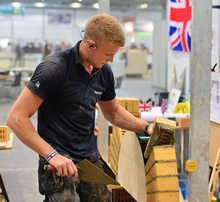 Above: Ashley Terron building a wall at WorldSkills 2013. Below: One of the walls he completed for the competition