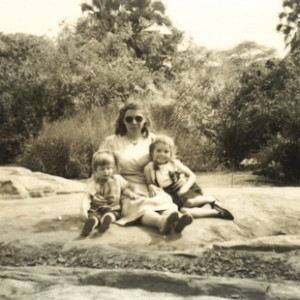 Layzelle with mum Anne and younger sister Sibell (right) by the Tsavo River, Kenya