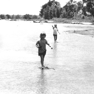 Layzelle and sister Sibell playing in the Athi River, Kenya