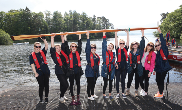 The all-girl South Worcestershire College team lift a whaling boat oar