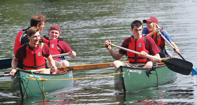 The Queen Elizabeth Hospital team paddle Canadian canoes