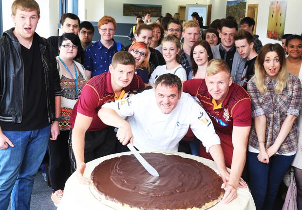 Rugby stars tackle giant jaffa cake