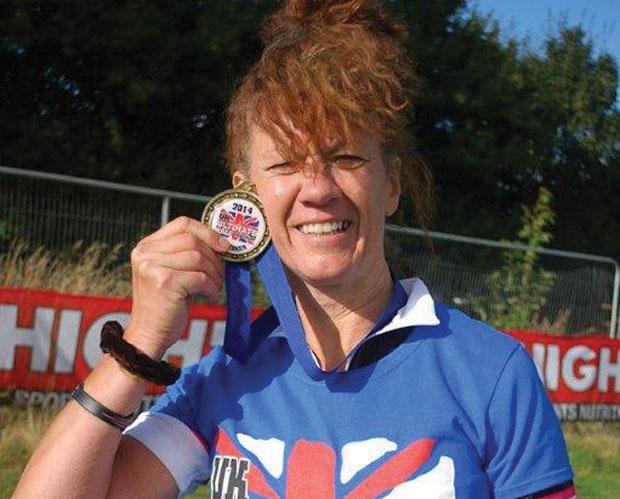 Breast cancer survivor completes half-triathlon