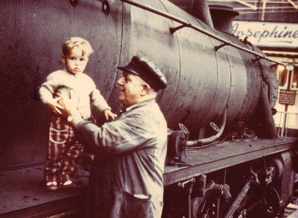 Wright, aged one, with grandfather Ernie, a train driver