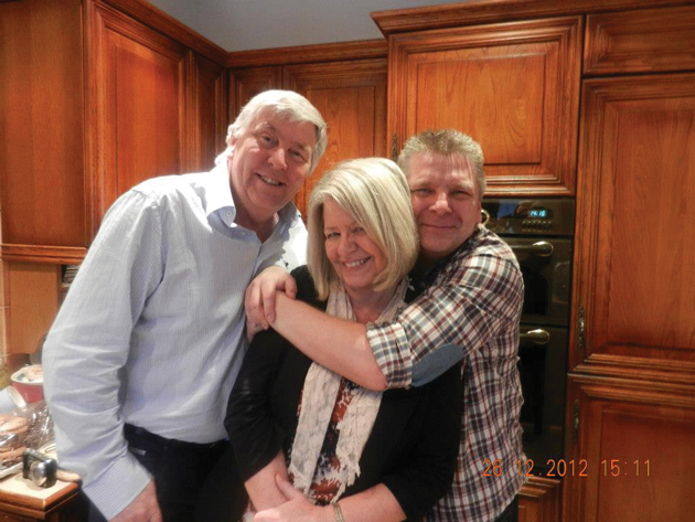Warner (right) with brother Mike and sister Sue, Christmas 2012