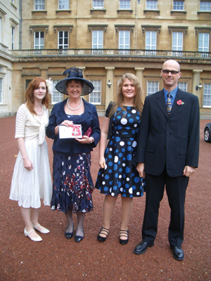 Westerman with daughter Aisling (left), husband Martin and daughter Tanith at the palace in 2010 when Westerman was awarded a CBE