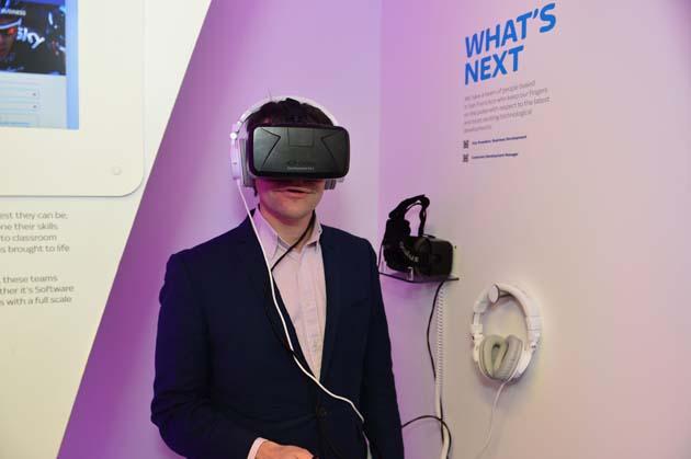 Paul wearing an immersive technology headset and earphones