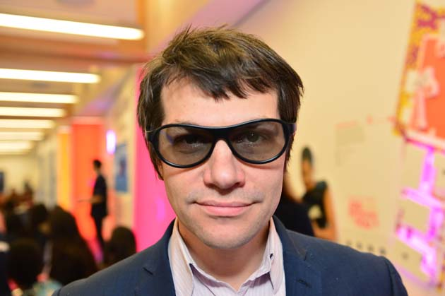 Reporter Paul Offord tries on 3D glasses in Sky Lab