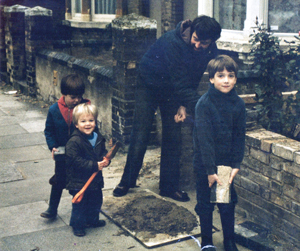 From left: Brothers Oliver and Tim, dad (Mike) and Benson. Building a wall outside their home in 1981