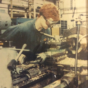 Towse, aged 17, using a lathe as an apprentice engineer