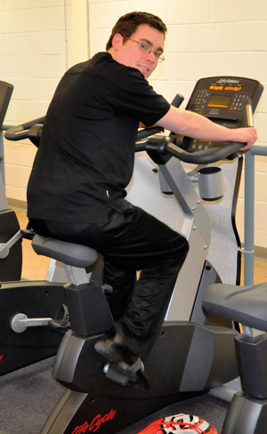 Owen Thomas trains for his 100 miles in-a-day cycle ride at GC gym