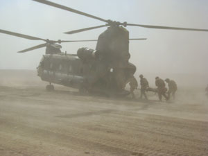 Peter being stretchered into a helicopter after hitting an IED in Afghanistan