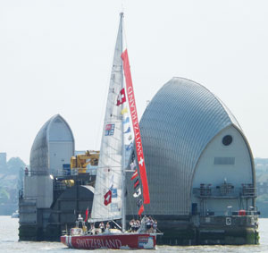 The Switzerland passing the Thames Barrier as it began its voyage