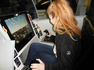 Susanna on board the Warhawk fighter jet simulator
