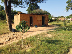 A hut that doubles-up as a school and healthcare centre in Zambia