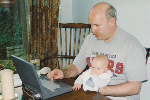 Hatton writing an inspection report in 1997, with help from son Patrick