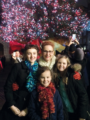 Cole's daughters Madeleine and Elspeth (middle left and right), wife Justine and daughter Isabelle on New Year's Eve 2014