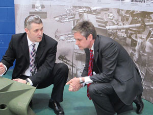 BAE Systems organisation development specialist Paul West (left) with Mr Woodcock at the company's Barrow site in April 2011