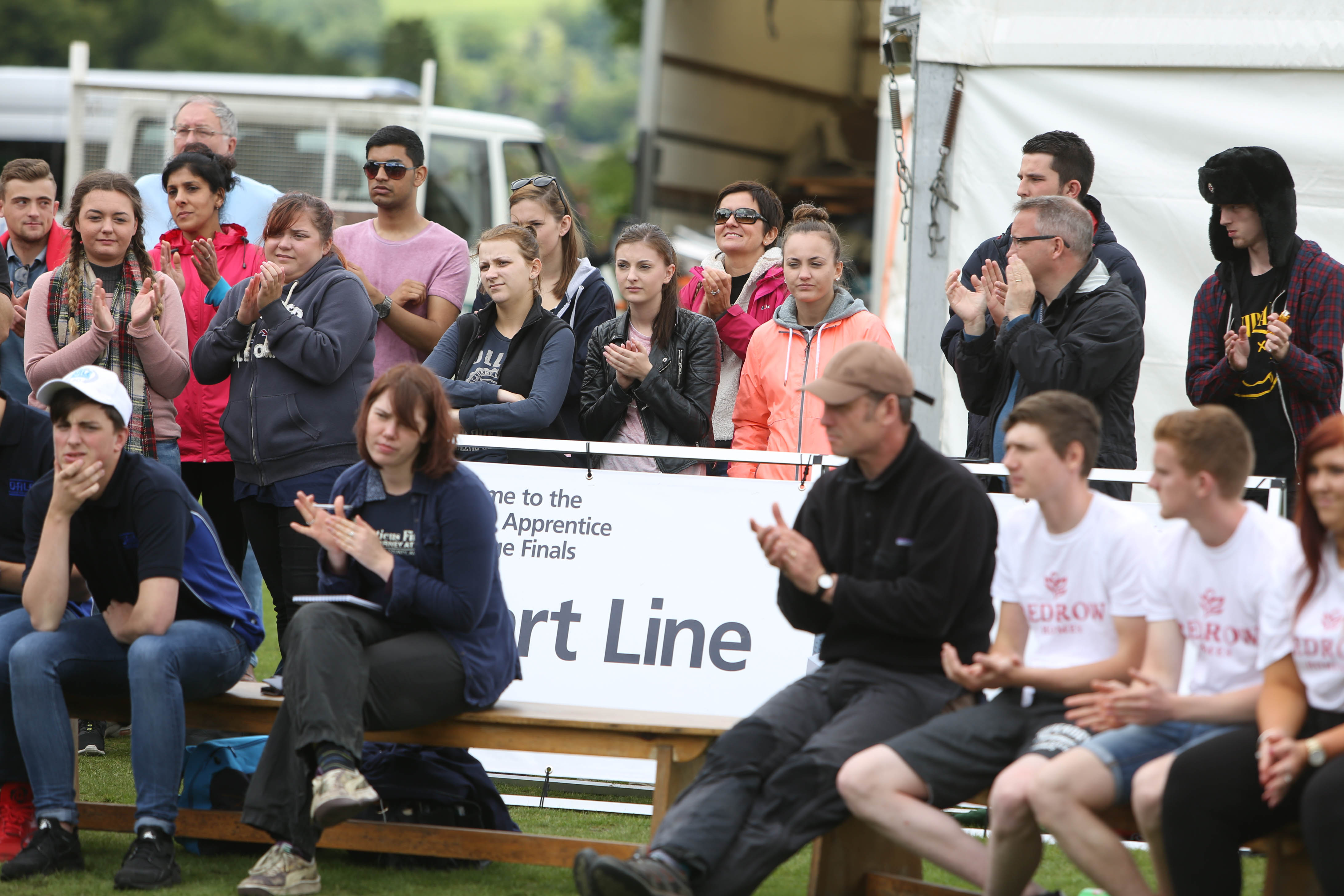 Reporter Rebecca Cooney (sitting second from left) applauds the apprentices