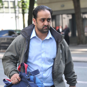 Akbar Hussain leaves Manchester Crown Court. Pic: MEN