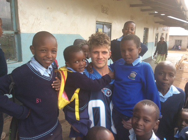 Deaf student Kieron Nugent with the Tanzanian school children