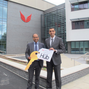 From left: Walsall College director of operations and resources Deb Rajania and principal Jatinder Sharma receive the key to The Hub