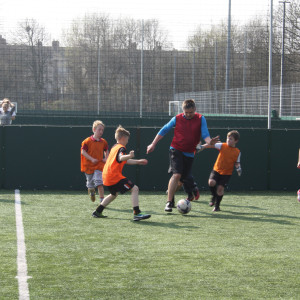 Woodcock takes on the younger generation in a game of football at Barrow park just before the general election this year