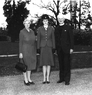 Legrave with her parents Edna (left), and Dermot (right) when she served in the army