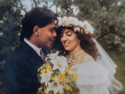 Khan with his wife Julie on their wedding day in June 1990