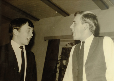 Cragg (right) sings with a friend while working in Germany in 1968
