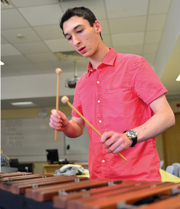 Chris Grabham playing a xylophone during a practice session