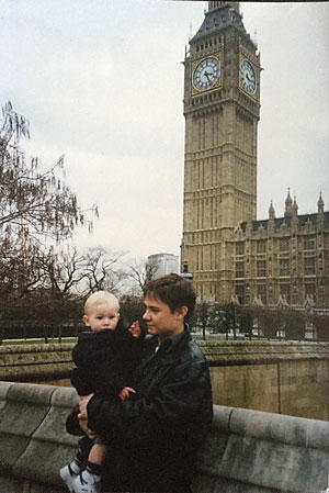Wright holding his year old son Ben in 1995 outside the Houses of Parliament