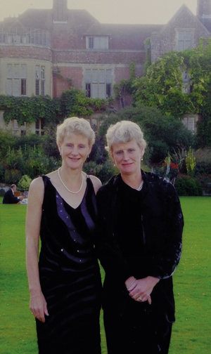 Legrave and her identical twin sister Brigid Simmonds together at a garden party