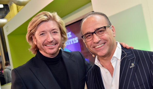 Busy day at the Skills Show for Theo Paphitis with visit to the hairdressers and the kitchen — and even the operating table
