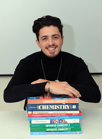 Edward with his chemistry books which he hopes will lead him to a career in medicine