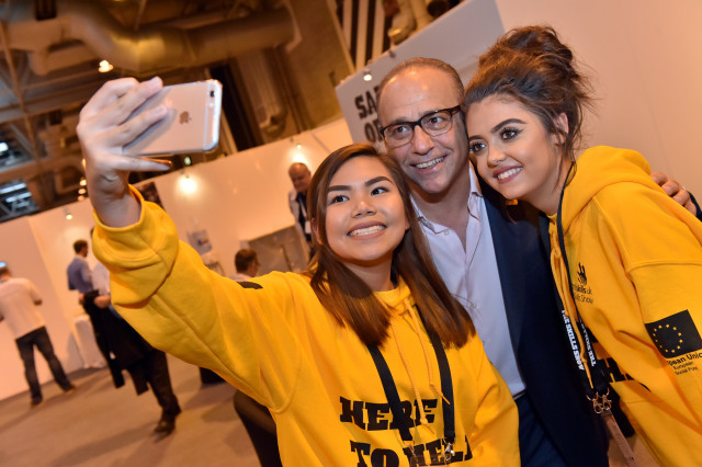Theo Paphitis poses with Skills Show volunteers for a selfie